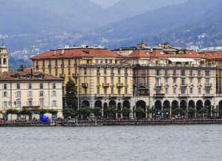 Featured Image: Close-up cityscape of Lugano city waterfront along Lugano Lake. Facades of historic houses in front of alp mountains. Courtesy: © 2017. Fotolia. Used with permission.